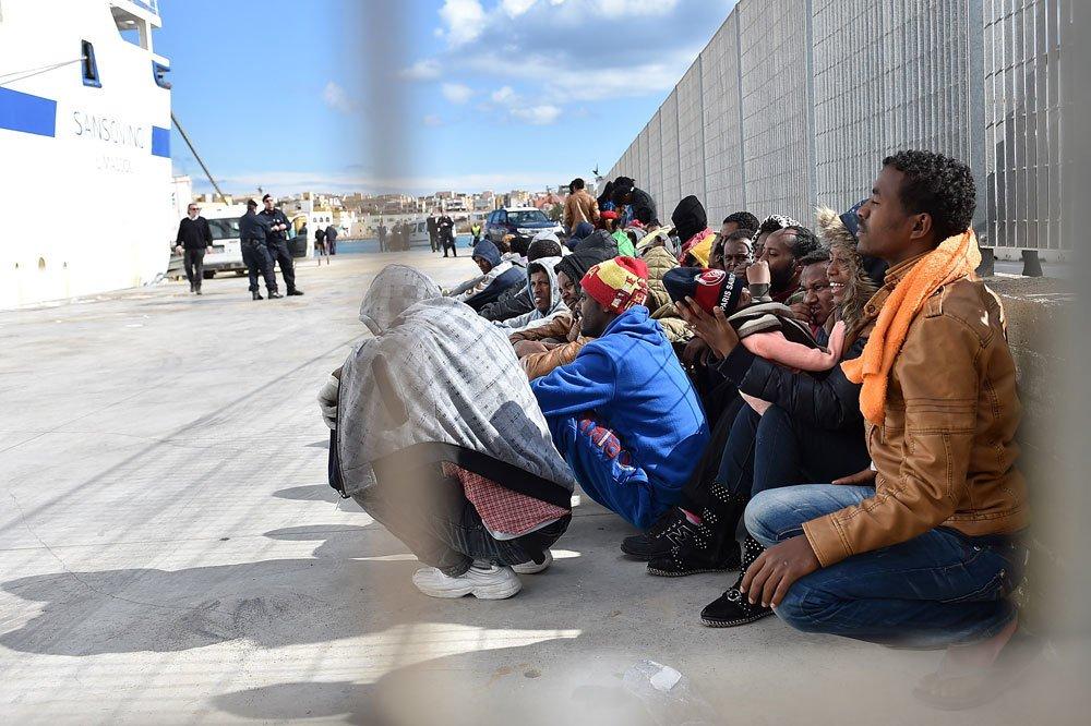 migranți
